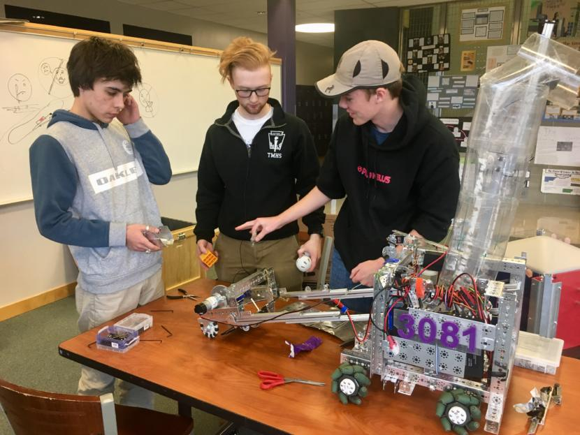 (From left) Eli Douglas, Noatak Post and Riley Sikes at a Thunder Mountain High School robotics practice on April 9, 2019. The trio has been building robots together since second grade. (Photo by Zoe Grueskin/KTOO)