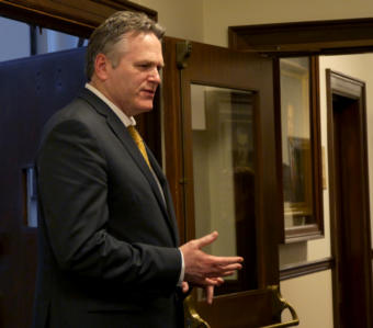 Gov. Mike Dunleavy talks with Sen. Lora Reinbold, R-Anchorage, in the 2nd floor hallway of the Capitol in Juneau on March 7, 2019. He had just left the House Speaker's office.