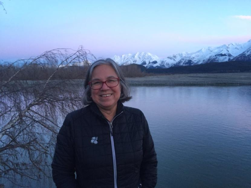 Kimberley Strong on the banks of the Chilkat River by her home.