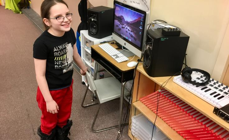 "Riverbend Elementary School 3rd grader Kallie Puustinen on March 26, 2019. Puustinen helped write a record a song about demo team, an activity she describes as ""like karate and gymnastics but kind of smooshed together."" (Photo by Zoe Grueskin/KTOO)"