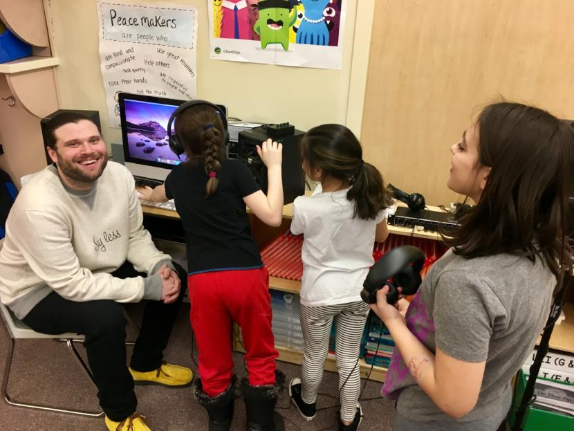 T.J. Cramer (left), stage name Manner, on March 26, 2019 with three of the Riverbend Elementary School students he's working with to produce a student-created album. (Photo by Zoe Grueskin/KTOO)