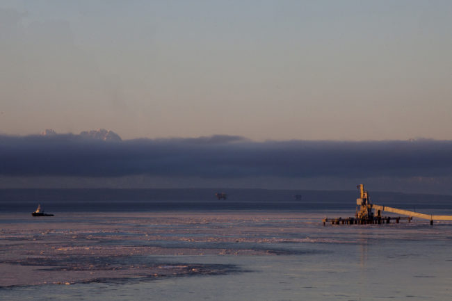 Cook Inlet oil platforms are visible from shore near Kenai, Alaska. (Photo by Rashah McChesney/Alaska's Energy Desk)
