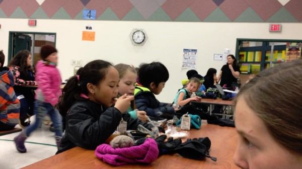 """Anchorage students eating during a """"silent lunch."""" (Screen grab of a Health, Wellness, Nutrition, and Student Learning Ad Hoc committee presentation via Kelly Lessens)"""