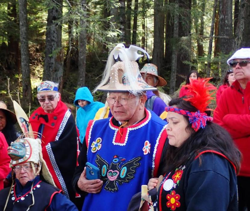 Hoonah community members Bill Wilson, Kenny Grant and Heather Powell hold a traditional Tlingit ground blessing for the site of a second cruise ship dock being built in partnership with Norwegian Cruise Lines and Huna Totem Corporation.
