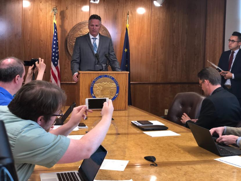 Alaska Gov. Mike Dunleavy speaks to reporters during a press conference at the Capitol, June 28, 2019.