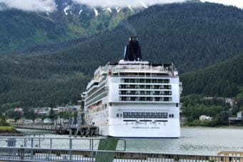 The Norwegian Jewel sits at port in Juneau with a faint plume of exhaust visible above it on June 13, 2019. (Photo by Adelyn Baxter/KTOO)