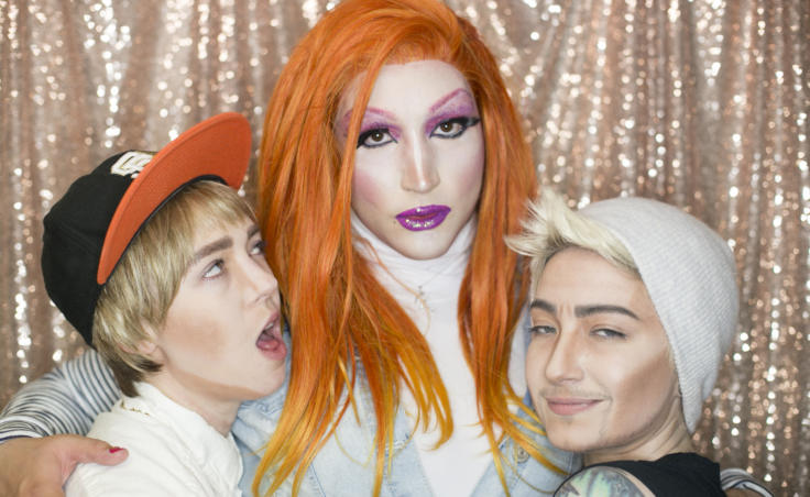 Three drag performers hug backstage. Drag performers Ryder Strong, Miss Guise, and Stevie Smalls pose backstage at Centennial Hall for the 5th Annual GLITZ Drag Show and Juneau Pride Kickoff on, June 14, 2019. (Photo by Annie Bartholomew/KTOO)