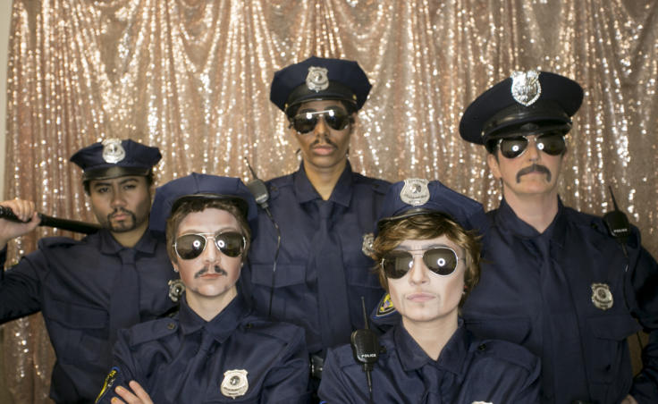 Juneau drag kings pose backstage dressed as police officers at Centennial Hall for the 5th Annual GLITZ Drag Show and Juneau Pride Kickoff at Centennial Hall on Friday, June 14, 2019. Performers Will Duja, Tyquan, Luke the Duke of Bell, Mikhail Van Jackson and Stevie Smalls took the stage for an opening number inspired by the 1969 Stonewall riots. (Photo by Annie Bartholomew/KTOO)