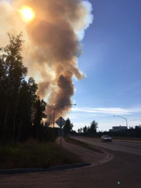 Smoke rises in the distance near Anchorage.