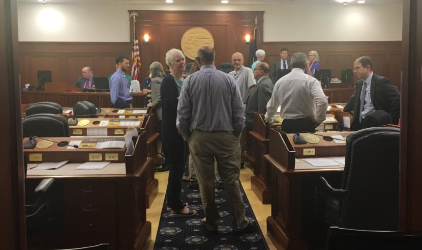 State representatives and senators mill around the Alaska House floor during a break in a joint session on Thursday. (Photo by Andrew Kitchenman/KTOO and Alaska Public Media)