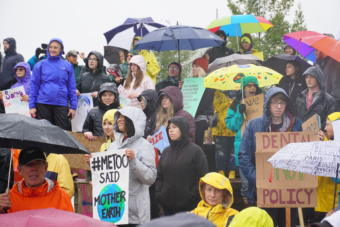 Participants in the Sept. 20 Climate Strike hold signs and listen to speeches at Cuddy Park in midtown Anchorage.