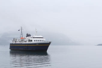 The Aurora, a 235-foot Alaska state ferry, approaches the dock in Whittier, its departure point for its trip across Prince William Sound to Cordova. (Photo by Nat Herz/Alaska's Energy Desk)