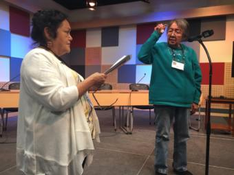 Gus'dutéen Bessie Jim (right) indicates a high tone on a letter at the 4th International Lingít Spelling Bee held in Juneau on Sep. 27, 2019. Virginia Oliver (left) gave the words and served as judge. (Photo by Zoe Grueskin/KTOO)