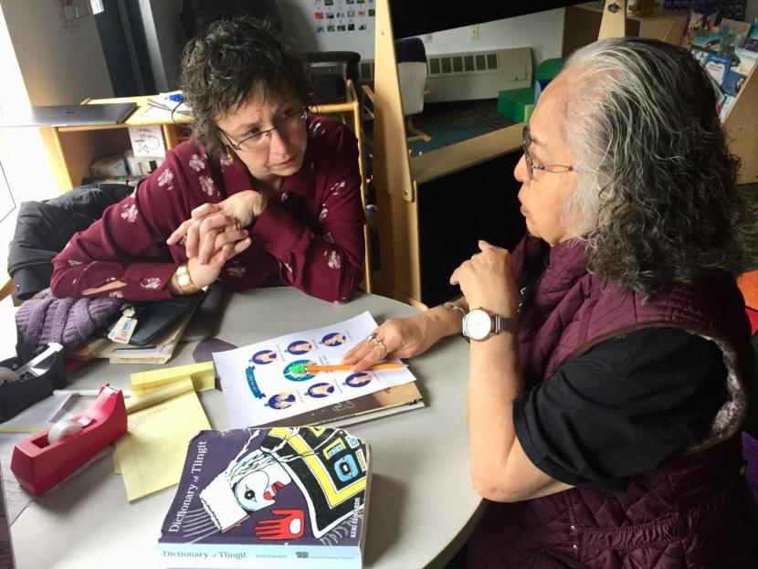 Daaljíni Mary Cruise (left) works on a lesson plan with Kaakal.aat Florence Marks Sheakley in the Haa Yóo X̱'atángi Kúdi Lingít immersion classroom in Juneau on Oct. 9, 2019. (Photo by Zoe Grueskin/KTOO)