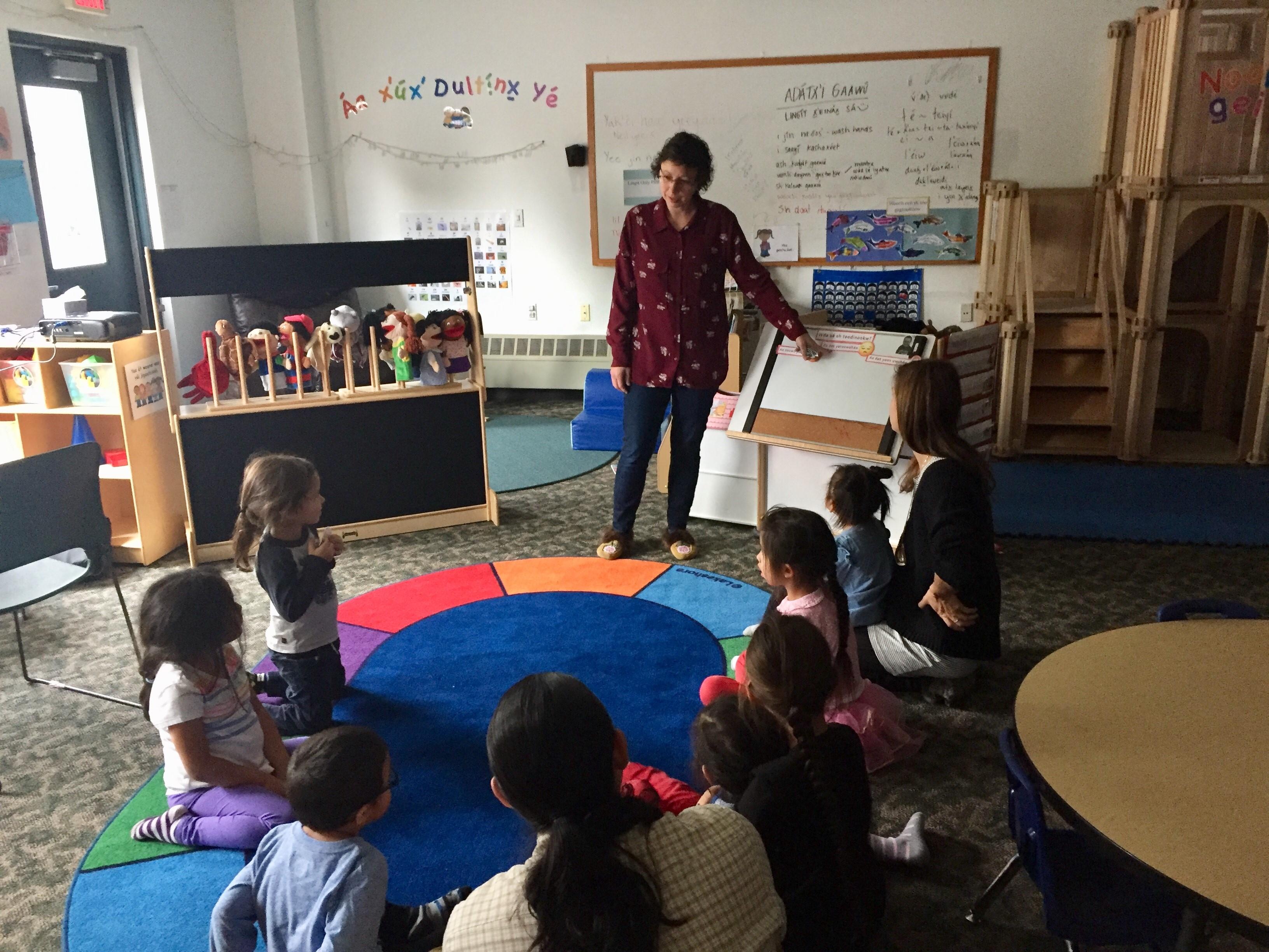 Daaljíni Mary Cruise leads circle time in the Haa Yóo X̱'atángi Kúdi Lingít immersion classroom in Juneau on Oct. 9, 2019. (Photo by Zoe Grueskin/KTOO)