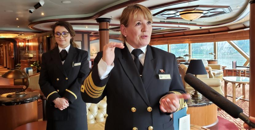 Capt. Inger Thorhauge answers reporters' questions from the Commodore Club aboard Cunard's Queen Elizabeth while it's in port in Juneau on May 18, 2019. It was the cruise ship's first visit to Juneau, though Thorhauge said she'd come to Alaska earlier in her career on much smaller ships.