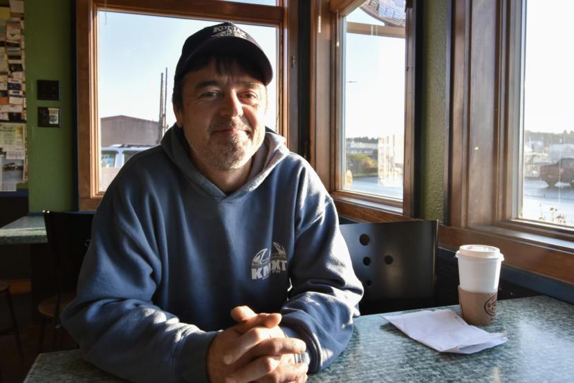 Darius Kasprzak, a jig fisherman, sits down for coffee near the Kodiak harbor. (Photo by Kavitha George/Alaska's Energy Desk)