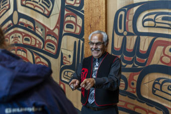 Sealaska Heritage Institute cultural interpreter John Lawrence talks to visitors at the institute's Walter Soboleff Building in downtown Juneau, Sept. 5, 2019. (Photo by Rashah McChesney/KTOO)