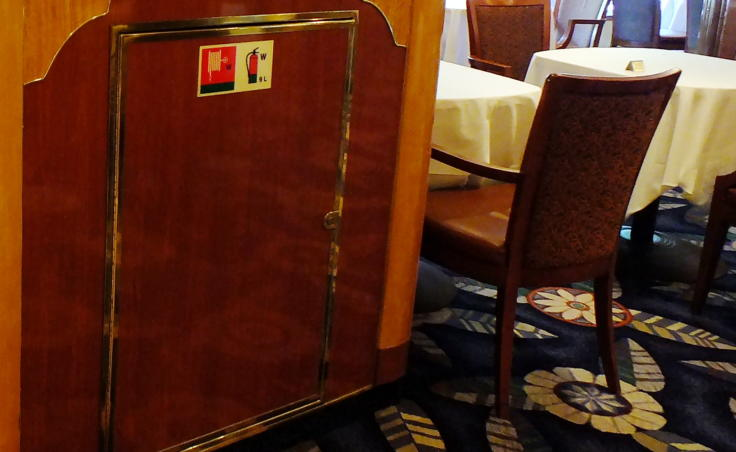 Firefighting resources are located all around the ship, sometimes hidden in plain sight in a dining room aboard the cruise ship Queen Elizabeth. (Photo by Matt Miller/KTOO)