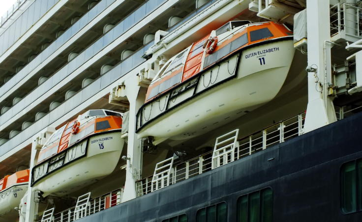 Tops of lifeboats for the cruise ship Queen Elizabeth are painted a color called international safety orange. (Photo by Matt Miller/KTOO)