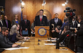 Gov. Mike Dunleavy unveils his budget on Wednesday, December11, 2019, at the Capitol in Juneau, Alaska. (Photo by Rashah McChesney/KTOO)
