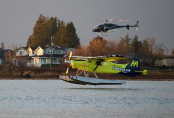 A de Havilland Beaver floatplane converted to electric battery-powered propulsion prepares to land on the Fraser River in Richmond, British Columbia, on Dec. 10, 2019.