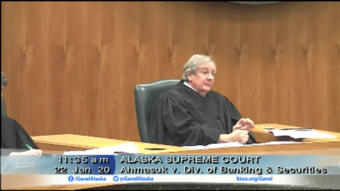 Supreme Court justice Daniel Winfree questions the state's broad authority to regulate shareholder speech during Wednesday's oral arguments in a case that tests the limit of free speech in Alaska Native corporation board elections. (Screenshots courtesy of KTOO/Gavel Alaska)