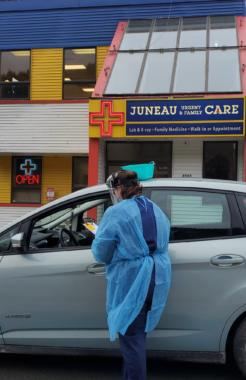 Sky Womack, of Juneau Urgent & Family Care, administers a drive-up test for coronavirus on Thursday, March 19, 2020 in Juneau, Alaska. (Photo courtesy Alicia McGuire)