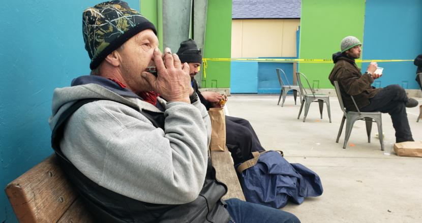 Cary Shilts plays the harmonica during the Glory Hall's lunch service at Zach Gordon Youth Center in Juneau on April 28, 2020.