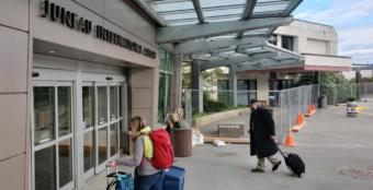 Travelers head into the terminal of Juneau International Airport on May 15, 2020.