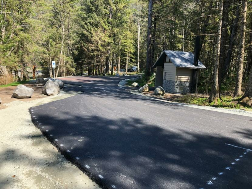 Glacier State Contractors paved over a dirt road in the U.S. Forest Service's Lena Beach Recreation Area, pictured here in May 2020.