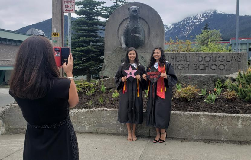 Maya Araujo, left and Jade Araujo pose for graduation photos outside Juneau-Douglas High School: Yadaa.at Kale on May 18, 2020.