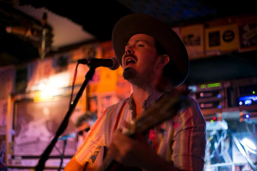 Tyson Davis plays with the band Blackwater Railroad Company, in July of 2019 in Juneau. Davis tested positive for COVID-19 in late June and is the band is asking people who attended shows in Fairbanks and Seward to get tested for the virus. (Photo courtesy Annie Bartholomew)