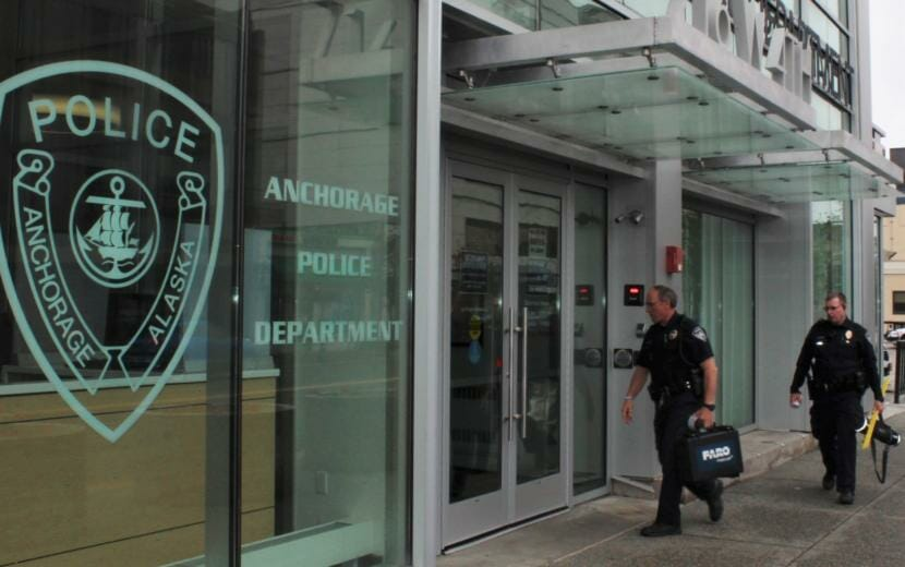 Anchorage police officers enter the downtown headquarters on Tuesday, June 9, 2020.