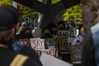 Organizers of a rally that drew more than 400 people to out in support of black community members and black people nationwide, read the names of black people who have been killed by police during a rally on Saturday, June 6, 2020, in Juneau, Alaska. It is the 11th day of nationwide protests against police violence and systemic racism following the death of George Floyd who was killed while being taken into custody by Minneapolis Police in late May. They repeated the message that Juneau is not immune and put out a list of demands including that a community oversight committee be formed to moniter the Juneau Police Department. (Photo by Rashah McChesney/KTOO)