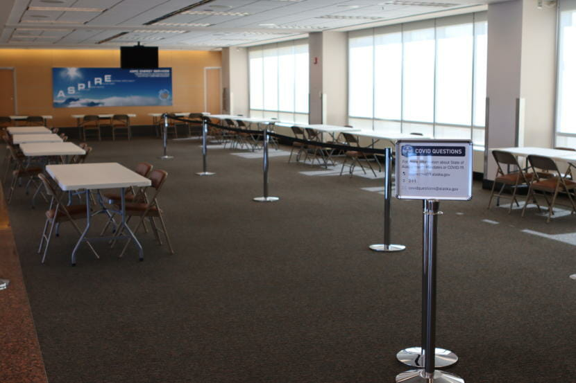 One of the new screening areas at the Ted Stevens Anchorage International Airport. Employees will take travelers' new declaration forms and any proof of a negative test result. They will also provide testing here. (Tegan Hanlon/Alaska Public Media)