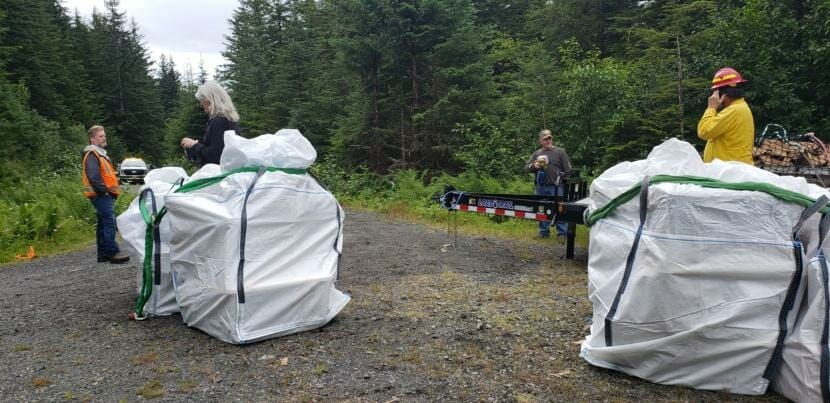 U.S. Forest Service personnel and a visitor wait for weather to clear near the Gastineau Meadows trailhead on Douglas Island after prepping supplies to be airlifted to the Dan Moller Cabin on Friday, July 24, 2020.