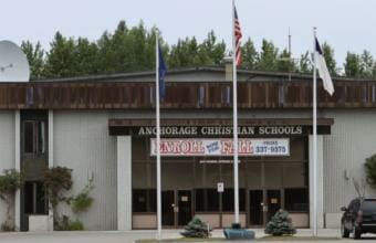 The entrance to Anchorage Christian Schools, including a banner advertising fall enrollment.