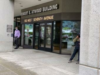 Workers were leaving the Atwood Building in downtown Anchorage on Friday, July 24, after concern about COVID-19 cases closed the state office building. (Julia O'Malley/Alaska Public Media)
