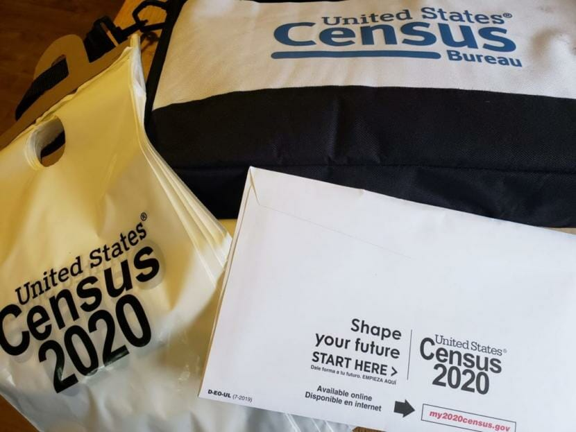 2020 Census materials including envelope and plastic bags for leaving census forms