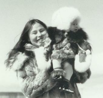 A woman holding up a baby during the 1982 contest.