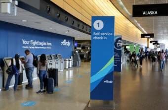 Departing passengers at Sea-Tac International Airport have lots of check-in kiosks to choose from with air traffic still way down from last year. (Photo courtesy Tom Banse/ NW News Network) TOM BANSE / NW NEWS NETWORK