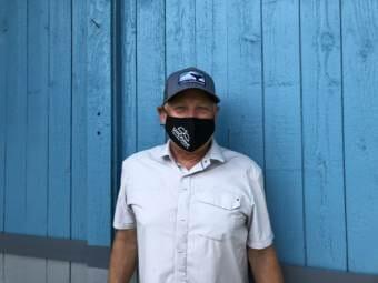 Portrait of Uncruise CEO Dan Blanchard wearing an Uncruise face mask