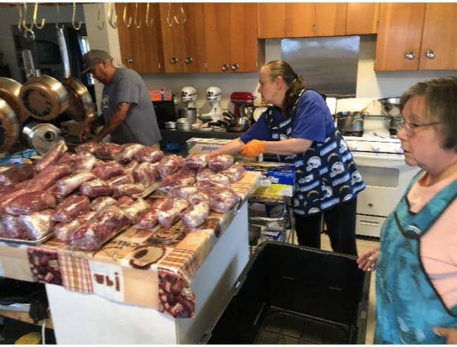 Kake residents and Elders process moose meat to be distributed to the community