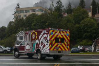 A newly refurbished ambulance decorated with art from Tlingit artists Mary Goddard and Crystal Worl drives through downtown on August 28, 2020 in Juneau, Alaska. (Photo by Rashah McChesney/KTOO)