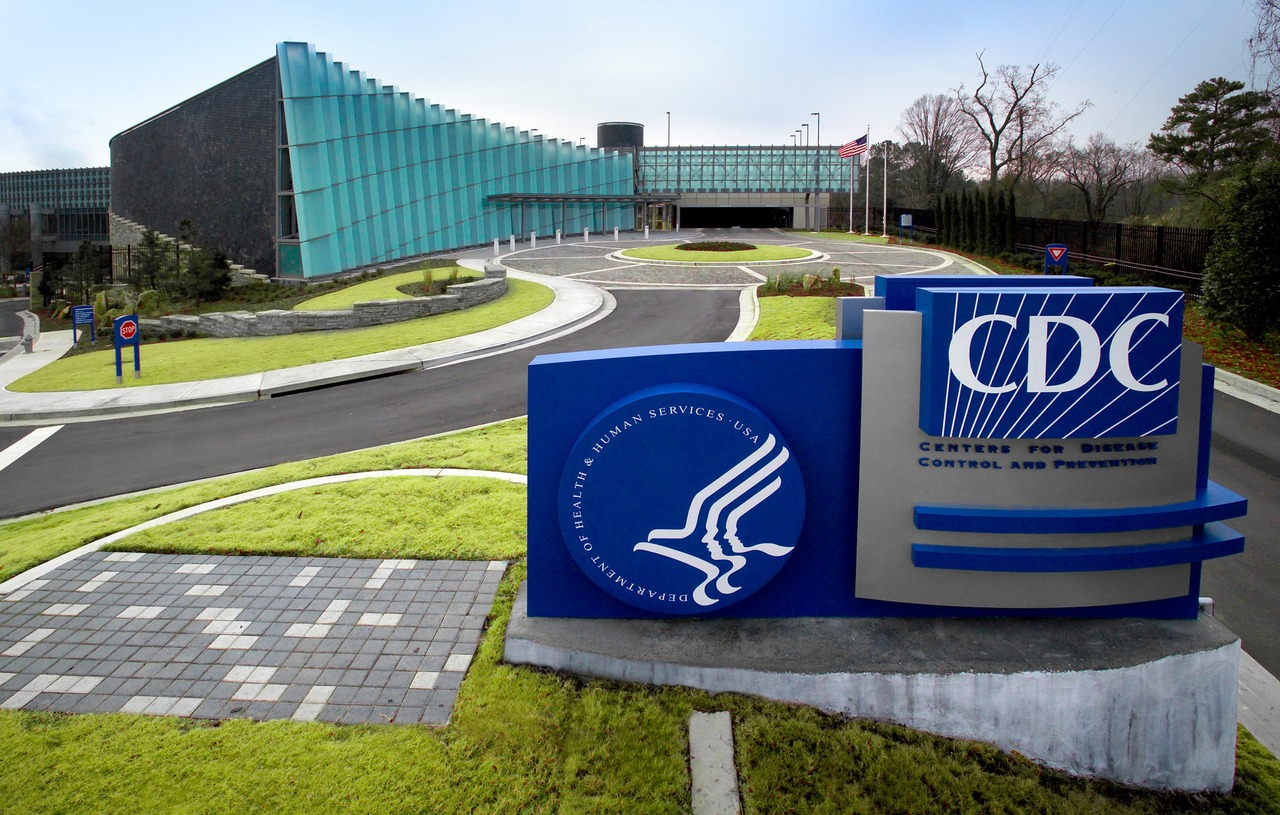 """The Centers for Disease Control Roybal campus in Atlanta, GA (James Gathany, CDC) Captured by James Gathany, Centers for Disease Control's biomedical photographer, this 2006 image depicted the exterior of the new """"Tom Harkin Global Communications Center"""", otherwise known as Building 19, located on the organization's Roybal Campus in Atlanta, Georgia. The facility houses the CDC's Information Center/Library, auditoria and meeting halls, which are used to accommodate in-house staff meetings, and national/international conferences hosted by the CDC, and the National Center for Health Marketing's, Division of Creative Services, which includes a full service television broadcast facility. The exhibit area currently features the <i>""""Global Symphony""""</i>, the first of several permanently installed exhibitions, and changing exhibitions that focus on a variety of public health topics. The exhibits in the Center are self-guided, and require no advance reservations. Additional curriculum-based exhibits and programming will be added in the future.<p><u>Tom Harkin Global Communications Center Exhibit Area Centers for Disease Control and Prevention</u><p>- 1600 Clifton Road, N.E., Atlanta, Georgia 30333<p>- Hours: Monday – Friday, 9 am – 5 pm, except for federal holidays Admission is free<p>- Government-issue photo ID is required for entry. Please note that CDC is a working federal facility and as such does not provide public tours of its campus and laboratories.<p>- For more information please call 404-639-0830."""