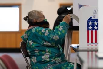 Edna Mathlaw of Bethel reads her ballot on Nov. 3, 2020 in Bethel, Alaska. (Photo by Katie Basile / KYUK)