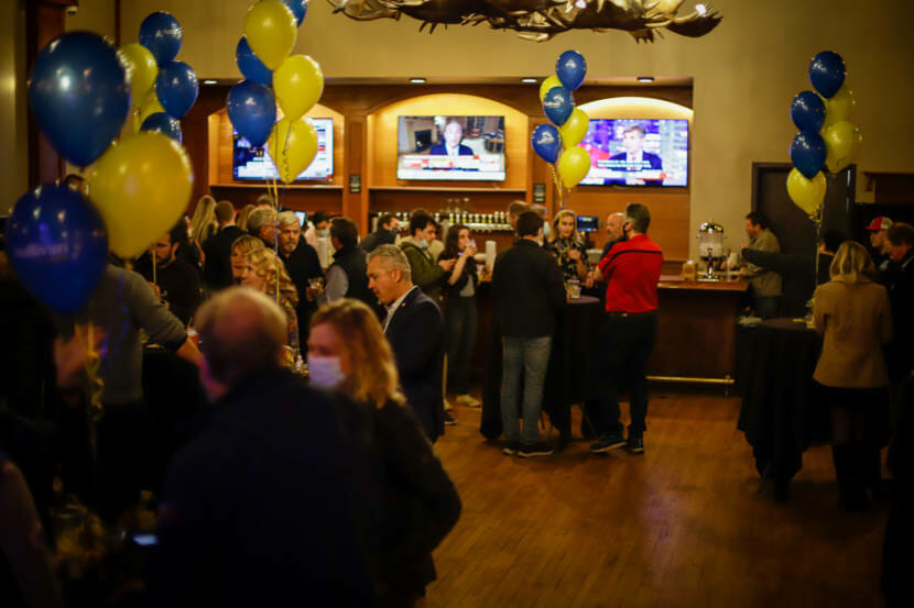 Supporters of Republican U.S. Sen. Dan Sullivan gather for an election night party at 49th State Brewing in Anchorage, Nov. 3, 2020. Republicans did well in the first day of vote counting, which concluded on Wednesday. But more than 133,000 more ballots will be counted next week. (Photo by Jeff Chen/Alaska Public Media)