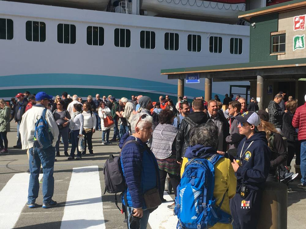 Passengers from the mega ship Norwegian Joy disembark in May 2019 at Ketchikan's Berth 3 downtown. (Photo by Leila Kheiry/KRBD)