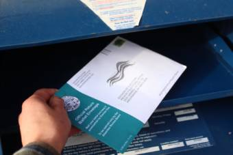 A voter mails an absentee ballot in October 2020.